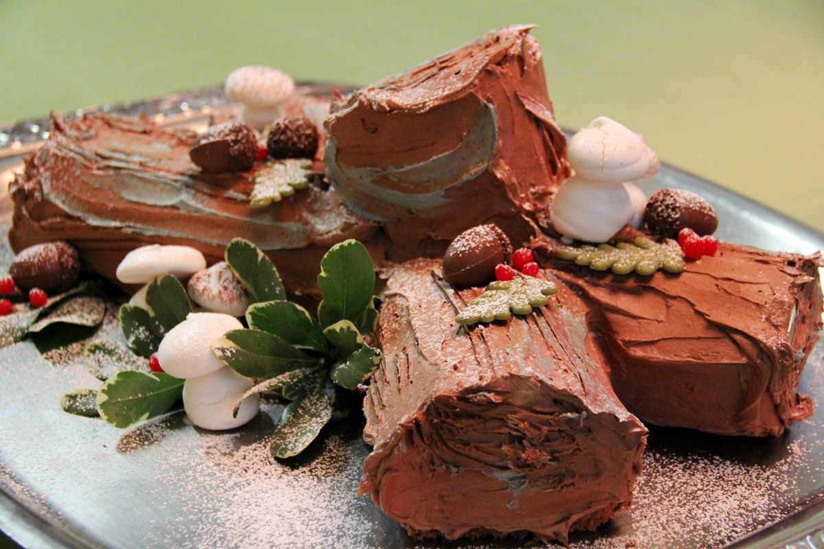 Wouldn't this decorative cake be the best holiday gathering surprise? Bring either the  black or white Bûche de Noël to your party for everyone's delight!  ~ Black Bûche de Noël ~  Thin layers of chocolate cake filled with chocolate mousse and topped with dark buttercream.
