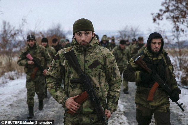 Seasoned fighters: Pro-Russian separatists from the Chechen 'Death Battalion' walk during a training exercise in the territory controlled by the self-proclaimed Donetsk People's Republic, eastern Ukraine