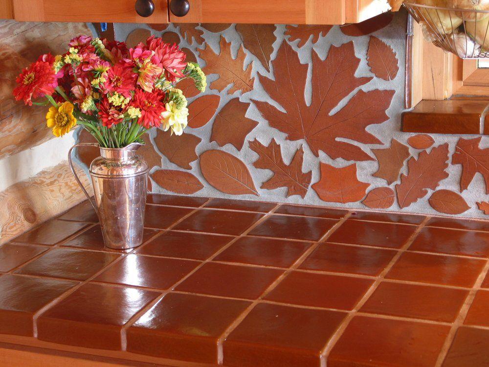 Terracotta leaf backsplash and terracotta tile countertop for Terracotta kitchen ideas