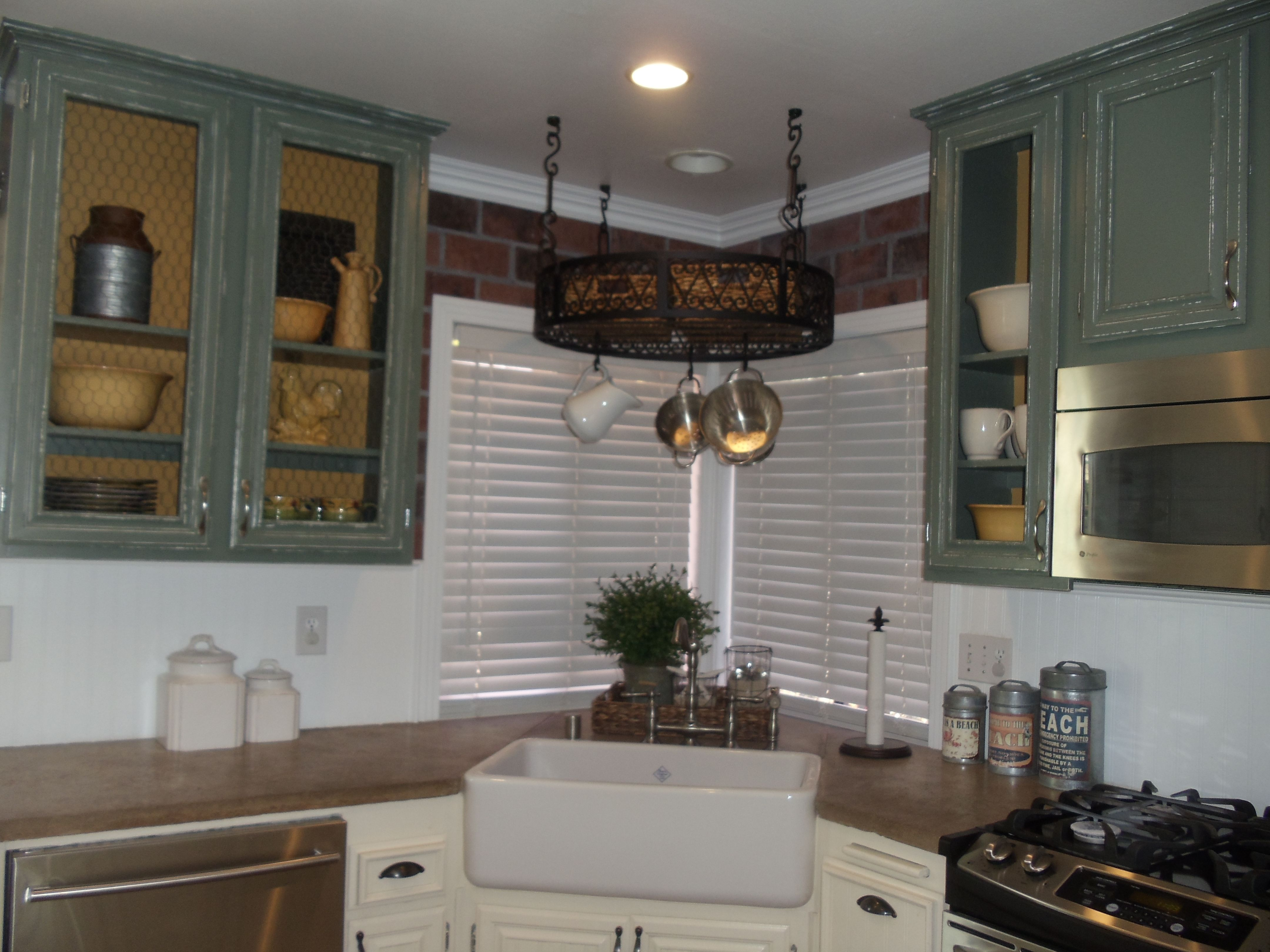 Country Kitchen....Original cabinetry painted and distressed ...