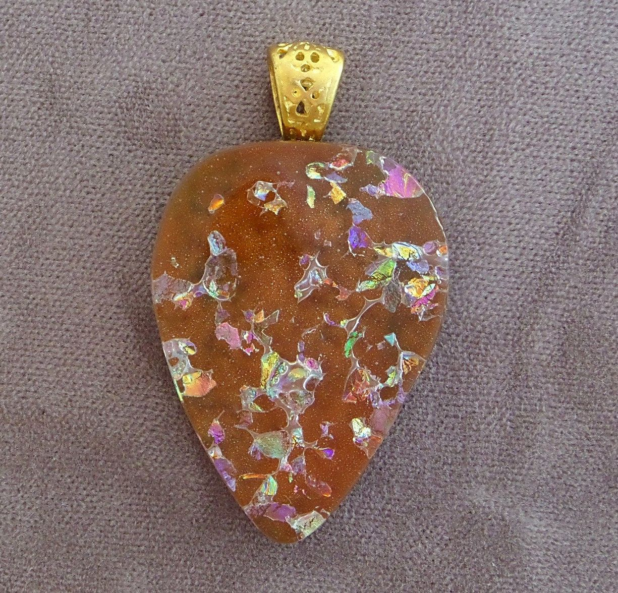 A personal favorite from my Etsy shop https://www.etsy.com/listing/253222381/amber-fused-dichroic-glass-pendant