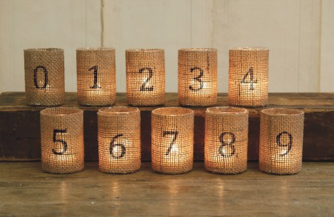 Burlap covered votives...then stencil numbers...perfect placecard markers or think cool advent calendar