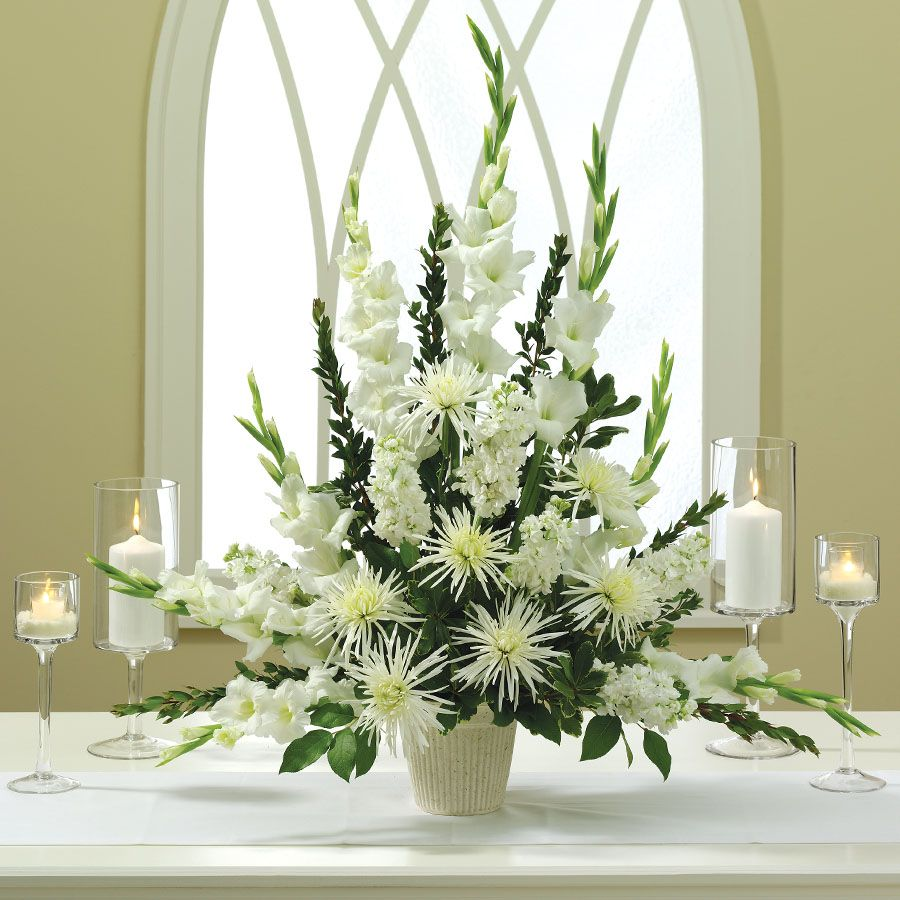 All white church wedding decor flowers arrangements from the sets of the good wife  BNJLR