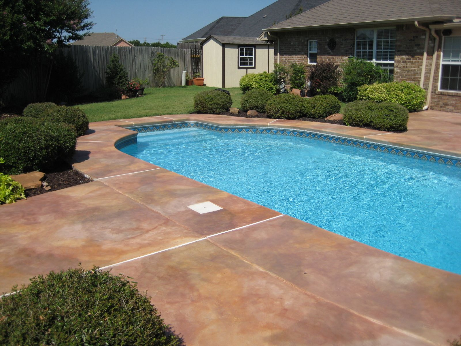 Stained concrete pool deck google search pool land for Concrete swimming pool
