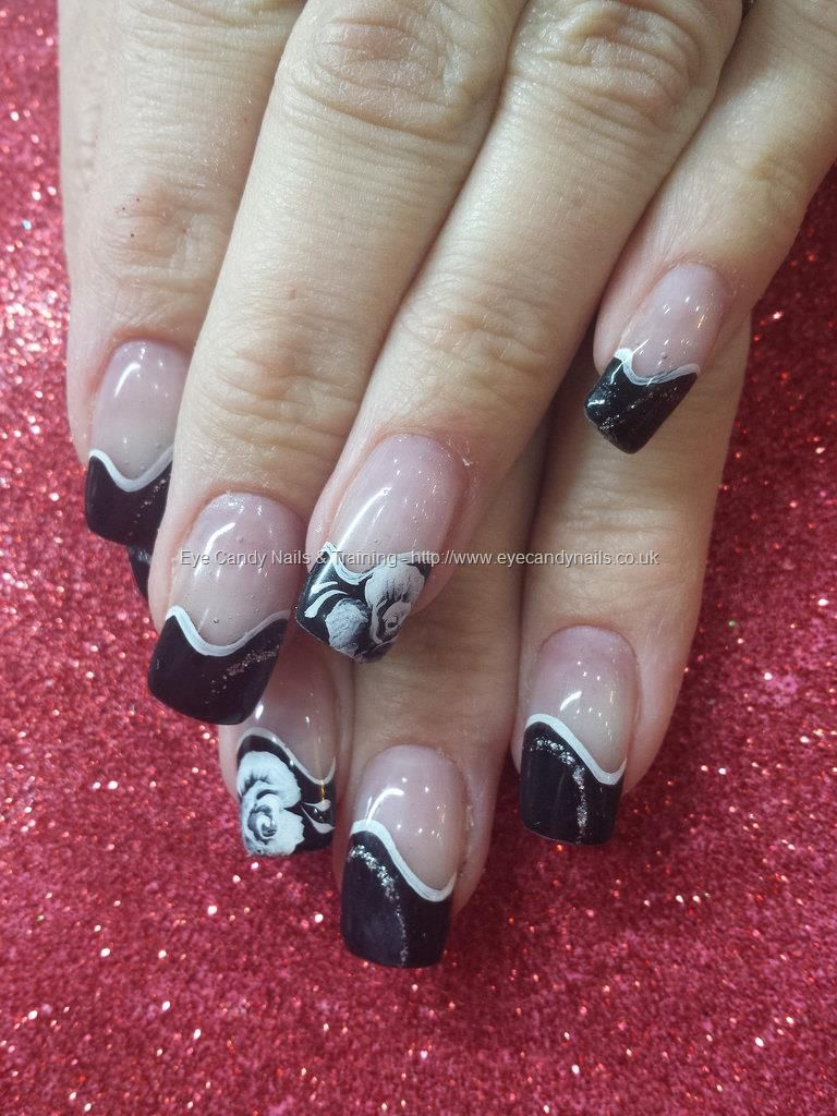 Black tips with one stroke flower nail art Technician:Elaine Moore ...
