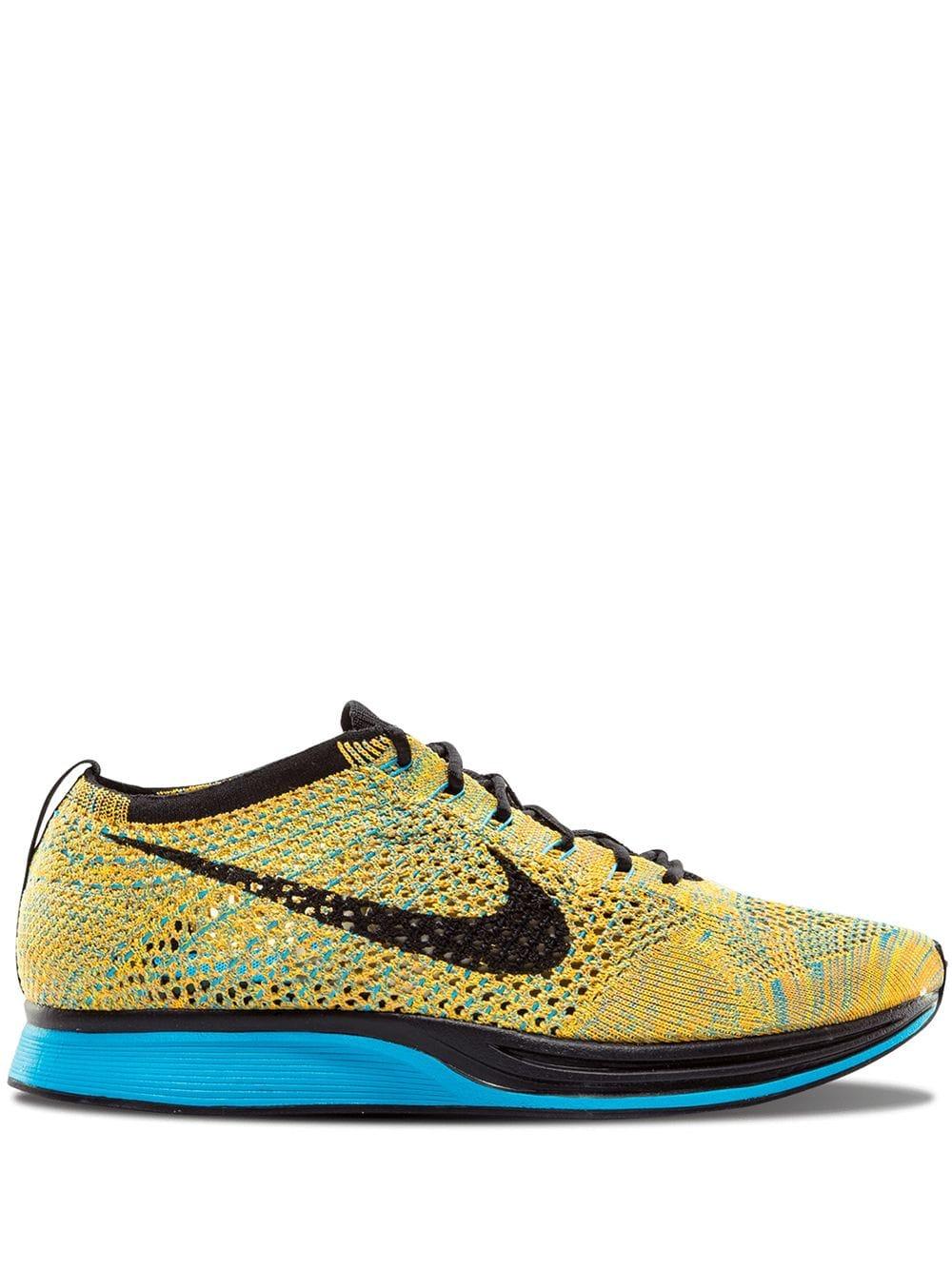 Nike Flyknit Racer Sneakers In Yellow