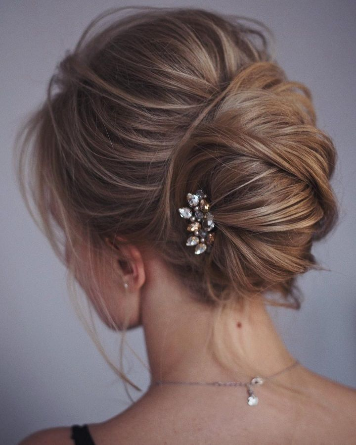 This french twist updo hairstyle perfect for any wedding venue ...