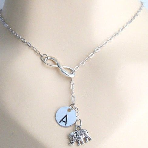 This gorgeous necklace features a silver plated elephant charm hanging lariat style through an infinity connector, personalized with your initial or gift necklace to your loved ones the elephant...@ artfire