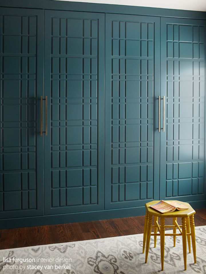 Dressing Room | Custom teal organized wall to wall closet. Asian shoji screen inspired. Hardware from DuVerre. Yellow eight leg side table doubles as ladder stool. Ikat rug sourced in Toronto. Design by Lisa Ferguson Interior Design www.lisafergusoninteriordesign.com >>>> PERSONALIZED, SENTIMENTAL and THOUGHTFUL + INNOVATIVE PROBLEM SOLVING full service interior & furniture design firm in Toronto, Canada <<<< [ photography Stacey Van Berkel ]