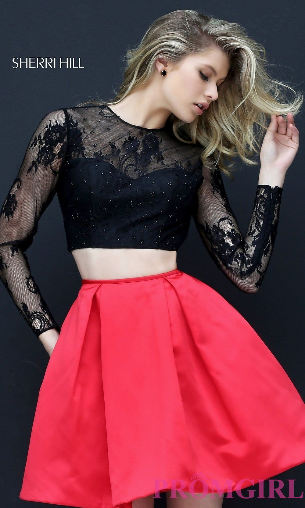 fdcd9102df2 Short two piece high neck fit and flare homecoming dress with long sleeves  and an open back by Sherri Hill.