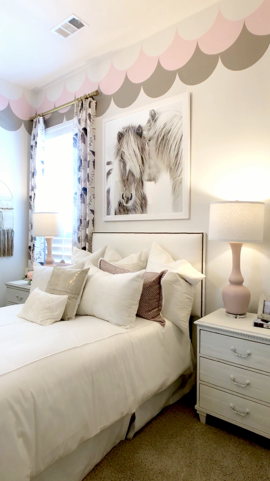 Cream, pink & taupe boho bedroom with woven wall hangings, horse art print & custom paint design.  Gorgeous model home tour - click to see more photos we took of this home.... Model home decor inspiration...THE DECORATING COACH #decoratingtips #bohobedroom #bohodecor #horseart #girlsbedroom #girlsbohobedroom