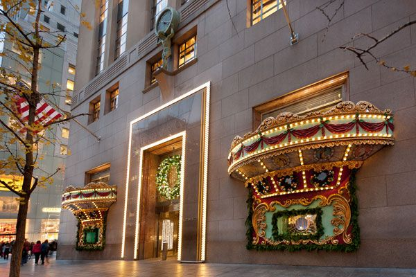 Tiffany Christmas Carousel- The small windows are brought to a larger scale with 3-D carousel awnings and framing on the exterior, drawing passersby into the window story.