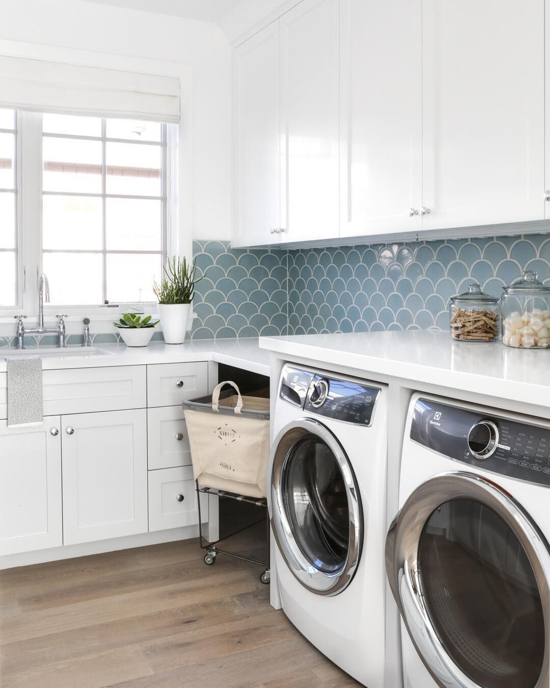 Modern Laundry Room With White Washer And Dryer Light Oak Floors