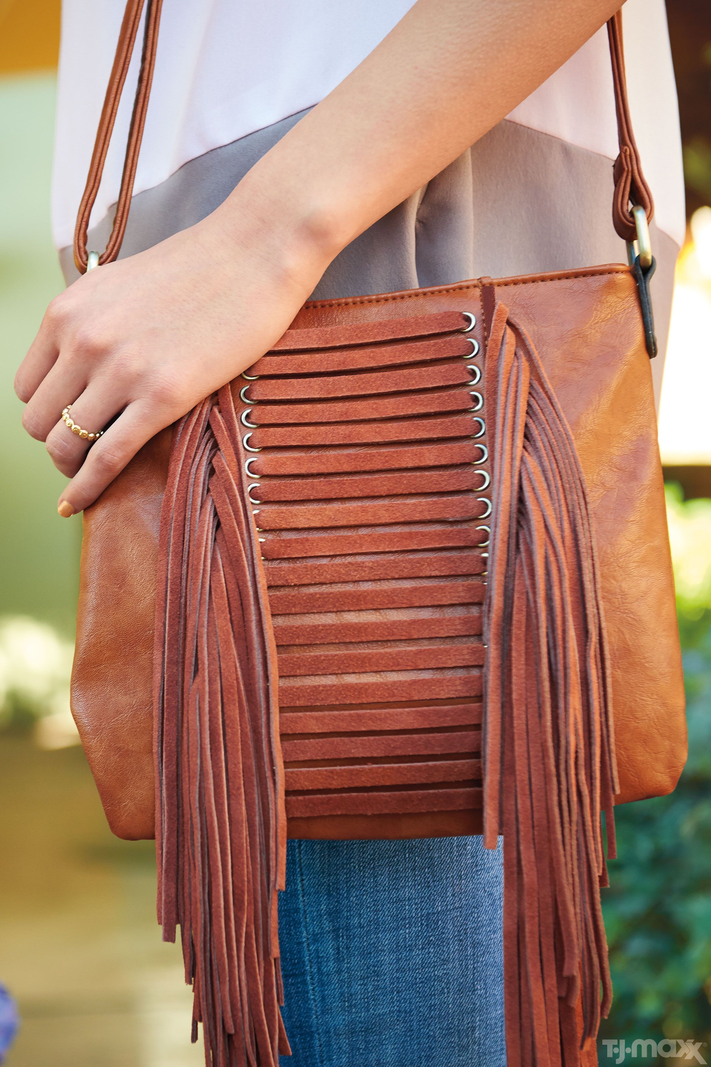 T.J.Maxx truth  You can never have too many great handbags. This fringe  cross-body style adds a boho touch to this silk blouse. c57df3479