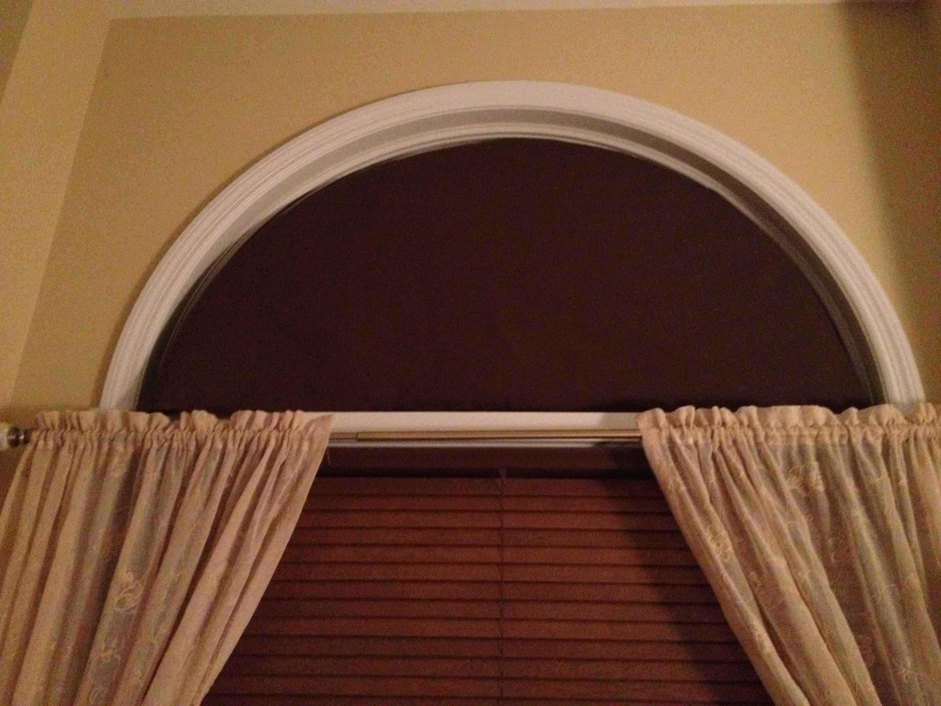 Home Made Arch Window Covering To Stop The Sun From Coming Into The Bedroom In The