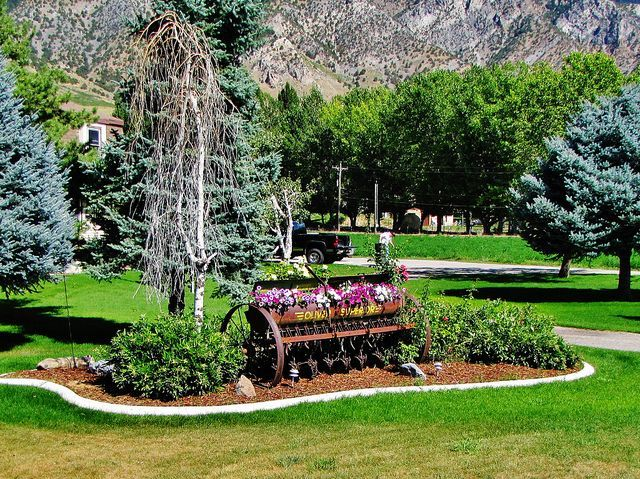 Image result for landscaping with antique farm equipment ...