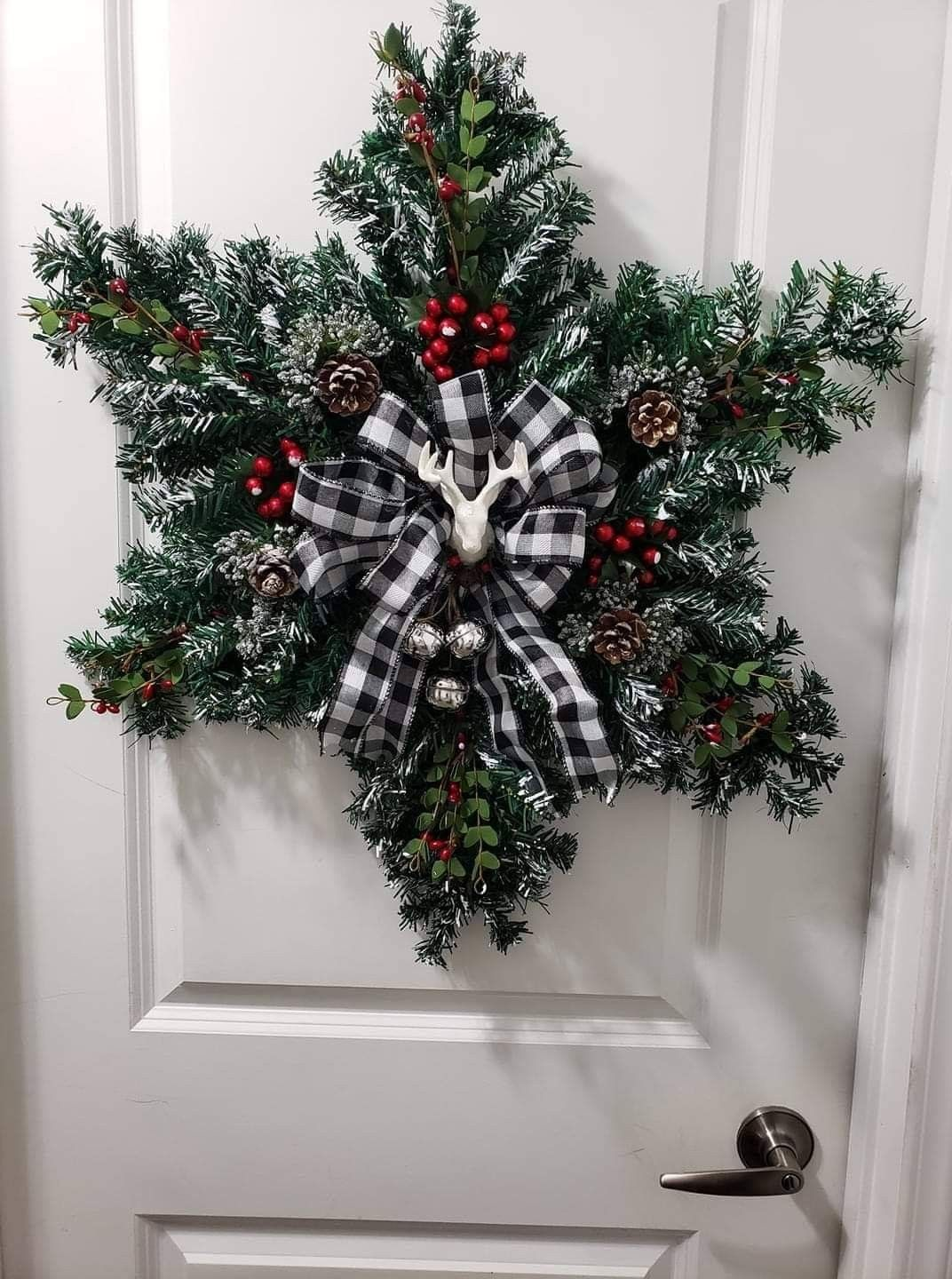 Snowflake wreath made out of small trees. https//m