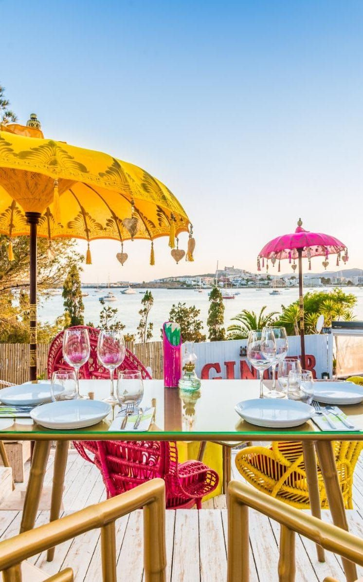 As the season kicks off, we round up the best beachfront restaurants the White Isle has to offer.
