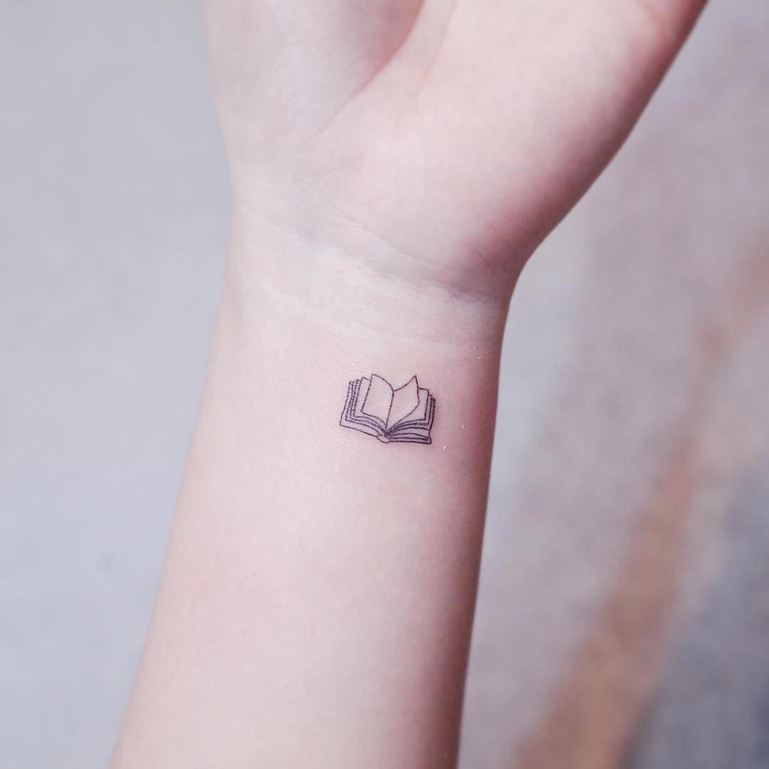 Book tattoo by witty button tattooremovalbeforeandafter