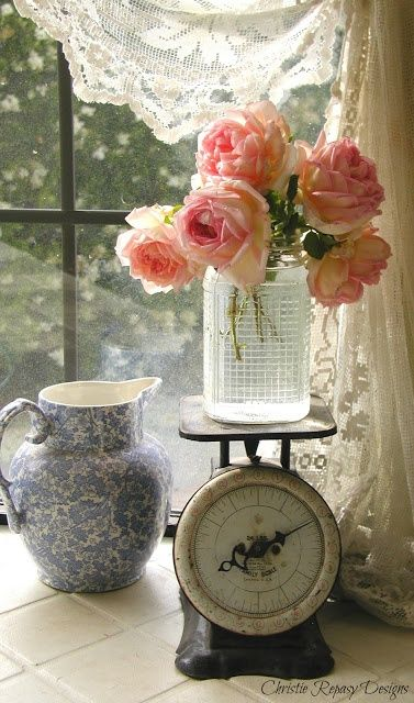 Roses on a vintage scale...kitchen window black..lace..vignette...so pretty and simple...your girl's need to feel pretty