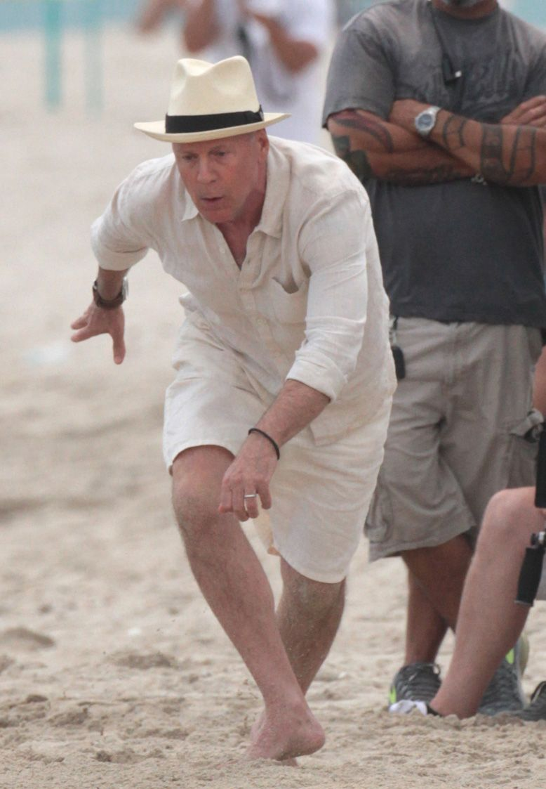 Actor Bruce Willis takes a tumble filming his commercial on