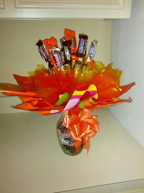 Bouquet Made With Fun Size Candy Bars Placed On Sticks And In Vase
