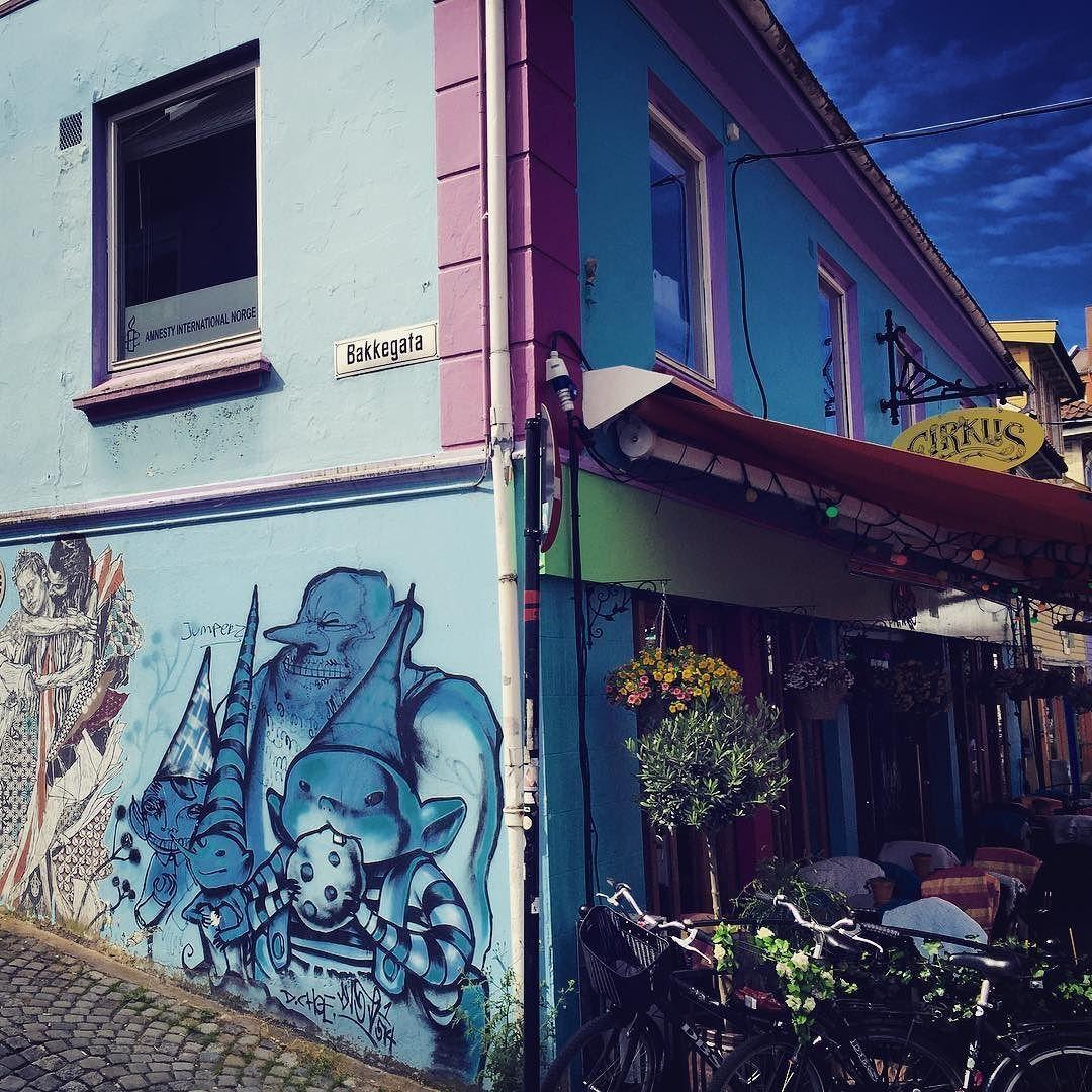 Colorful street in stavanger. Great streetart meets rainbow-colored Cafés and Bars.  #discovernorway #Stavanger #graphicdesign #streetart #colorful #summer #cafe #bar #flowers #bikes #hollandbikes #blue and #pink #and #Green #illustration #vanlife #vanlifediaries #roadtrip #skandinavia #instatravel #instagood
