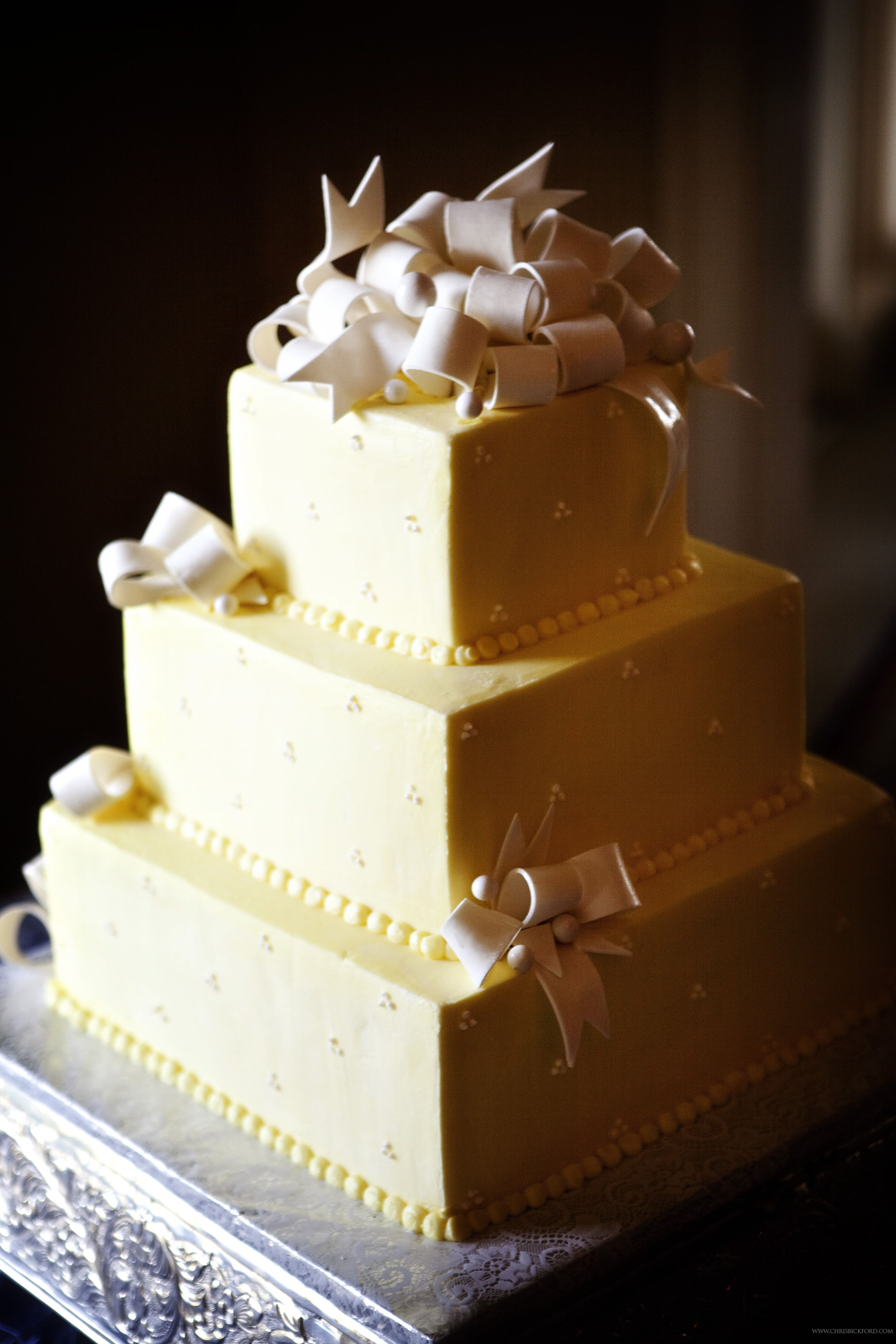 Three tiered square cake with ribbon details.  Photo by Chris Bickford  www.engagingeventsobx.com  #engagingeventsobx #outerbankswedding