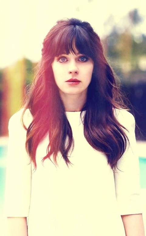 We Love The Quirky Zooey Deschanel But We Love Her Long Dark Locks With Seriously Thick Bangs Even More Hair Styles Zooey Deschanel Hair Long Hair Styles