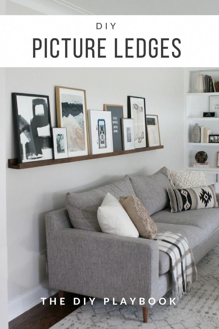 How to build DIY picture ledges so you can display art in your family room. These easy ledges are great because you can swap out the art in your living room on a whim! Plus, this is a great way to showcase art above your couch! #pictureledge #wallart #livingroom #abovethecouch #livingroomstorage