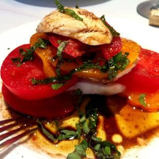 Summer is the perfect time of year to enjoy a delicious Caprese salad with heirloom tomatoes!