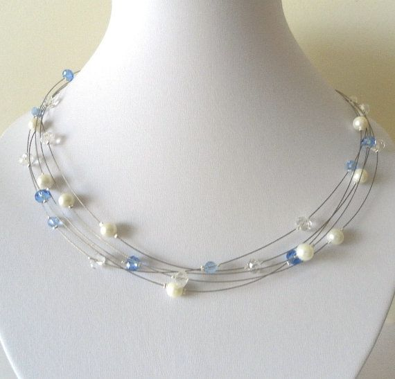 White and blue translucent crystallike bead and by JuliaJewellery, $19.00
