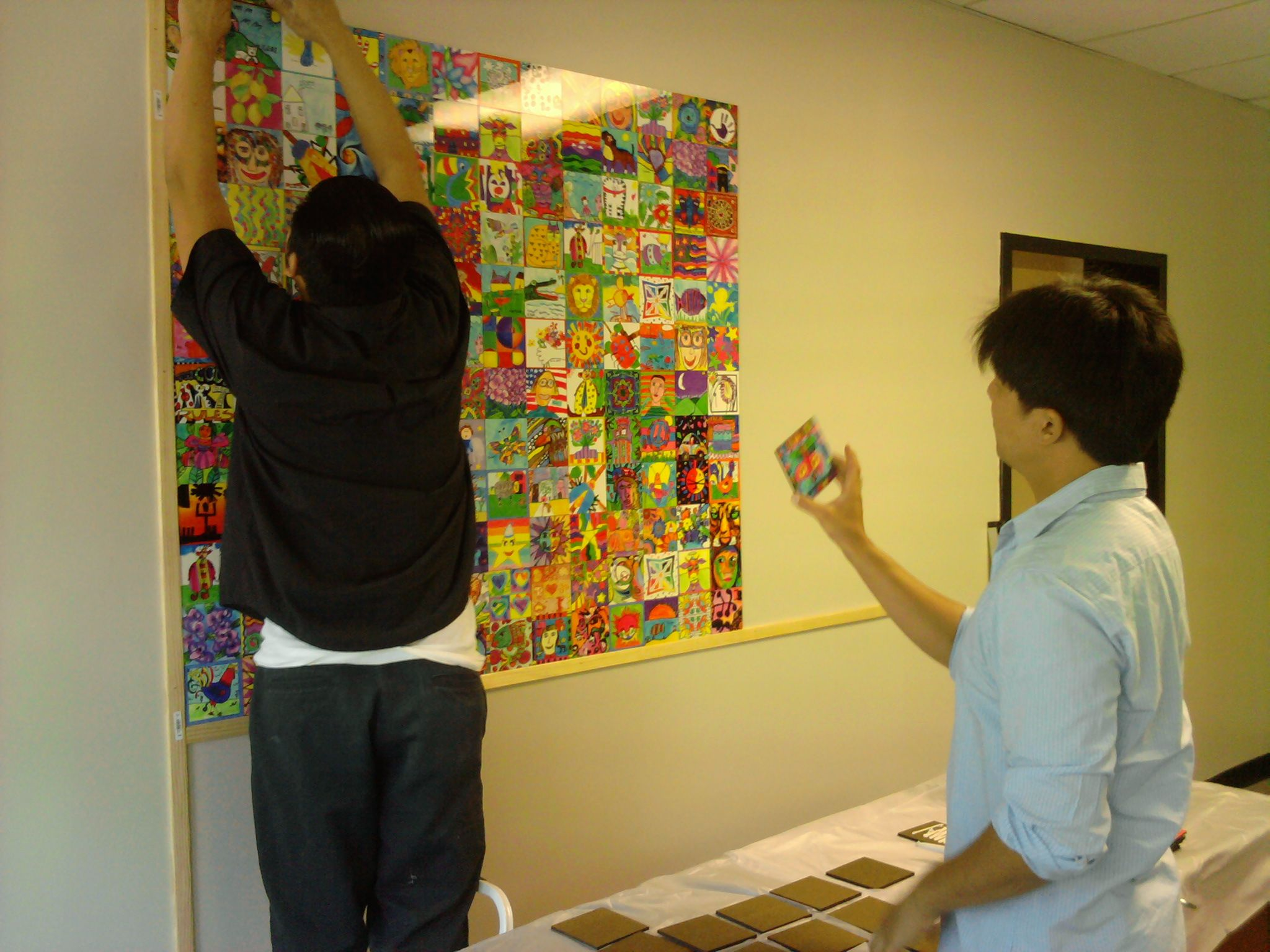 Hau and Eric creating our beautiful art wall. | Meet Square 1 Art ...