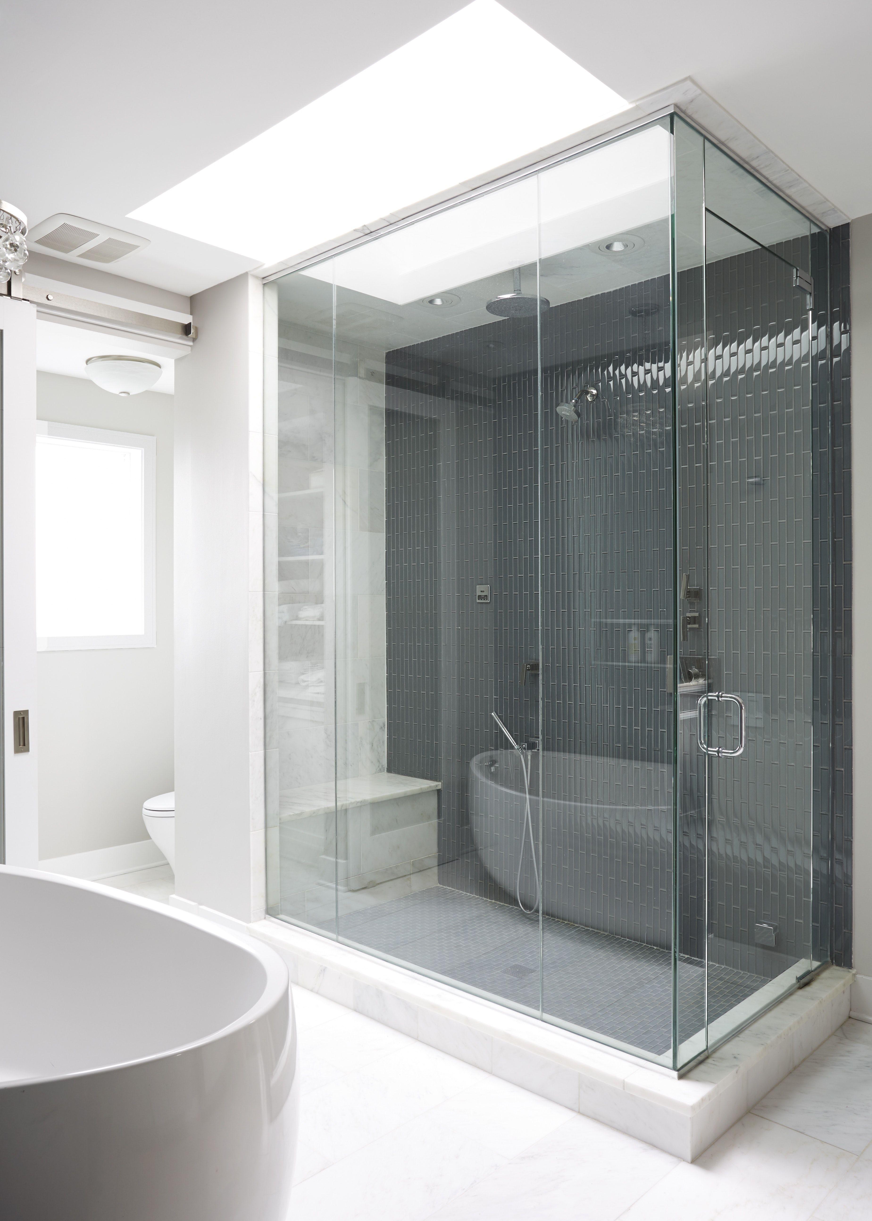 modern condo master bathroom blue tile shower marble skylight rh pinterest com