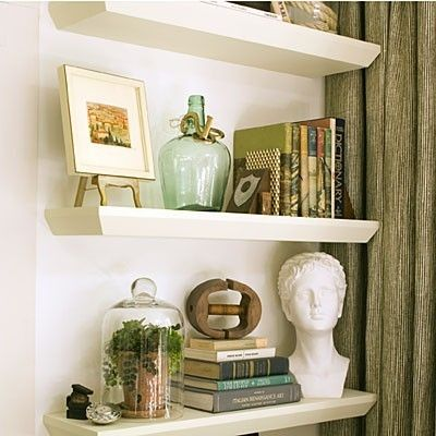 shelf styling Bust  Plant in jar Picture on stand