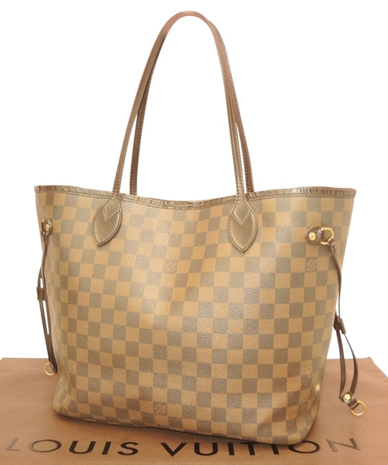 Louis Vuitton Damier Ebene Neverfull Mm Shoulder Bag. Get one of the hottest styles of the season! The Louis Vuitton Damier Ebene Neverfull Mm Shoulder Bag is a top 10 member favorite on Tradesy. Save on yours before they're sold out!