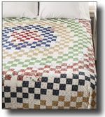 """Flower Bed Quilt Construction of a """"circular"""" design is created from the simple """"building blocks"""" of 9-patch units and rectangles."""