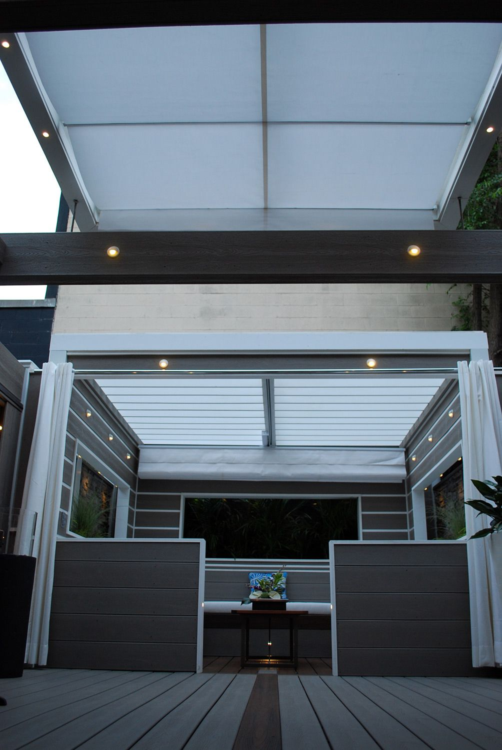 Retractable Awnings Provide Total Privacy From Tall Buildings Overhead While Still Letting In Lots Of