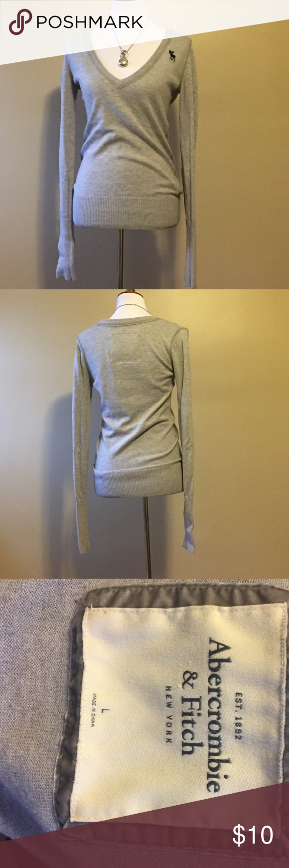 Abercrombie & Fitch Deep V Knit Sweater Abercrombie & Fitch. Size large. Deep V-neck. Long sleeve. Knit. Abercrombie & Fitch Sweaters V-Necks