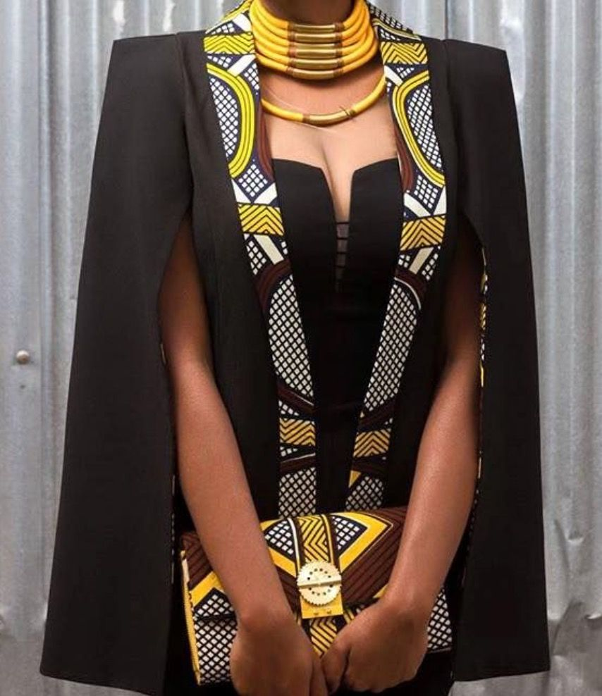 This jacket/top is Stunning Black/gold with black /gold accessories it is a memorable ensemble