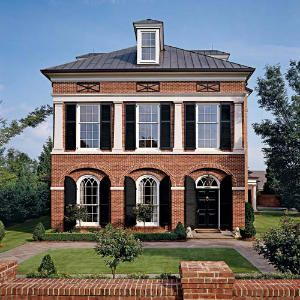 Things we love dormers black shutters metal roof and for Red brick house with metal roof
