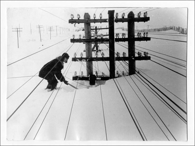 Telephone poles buried in snow in Russia.