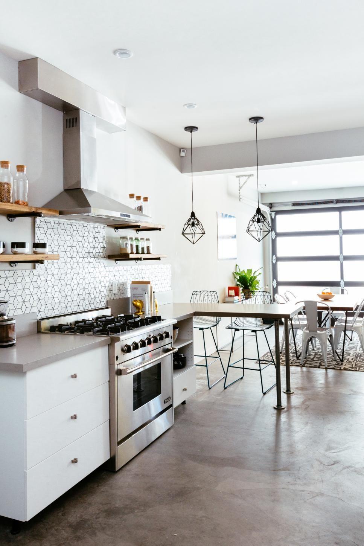 Concrete Floor and Steel and Glass Garage Door in Communal Kitchen ...