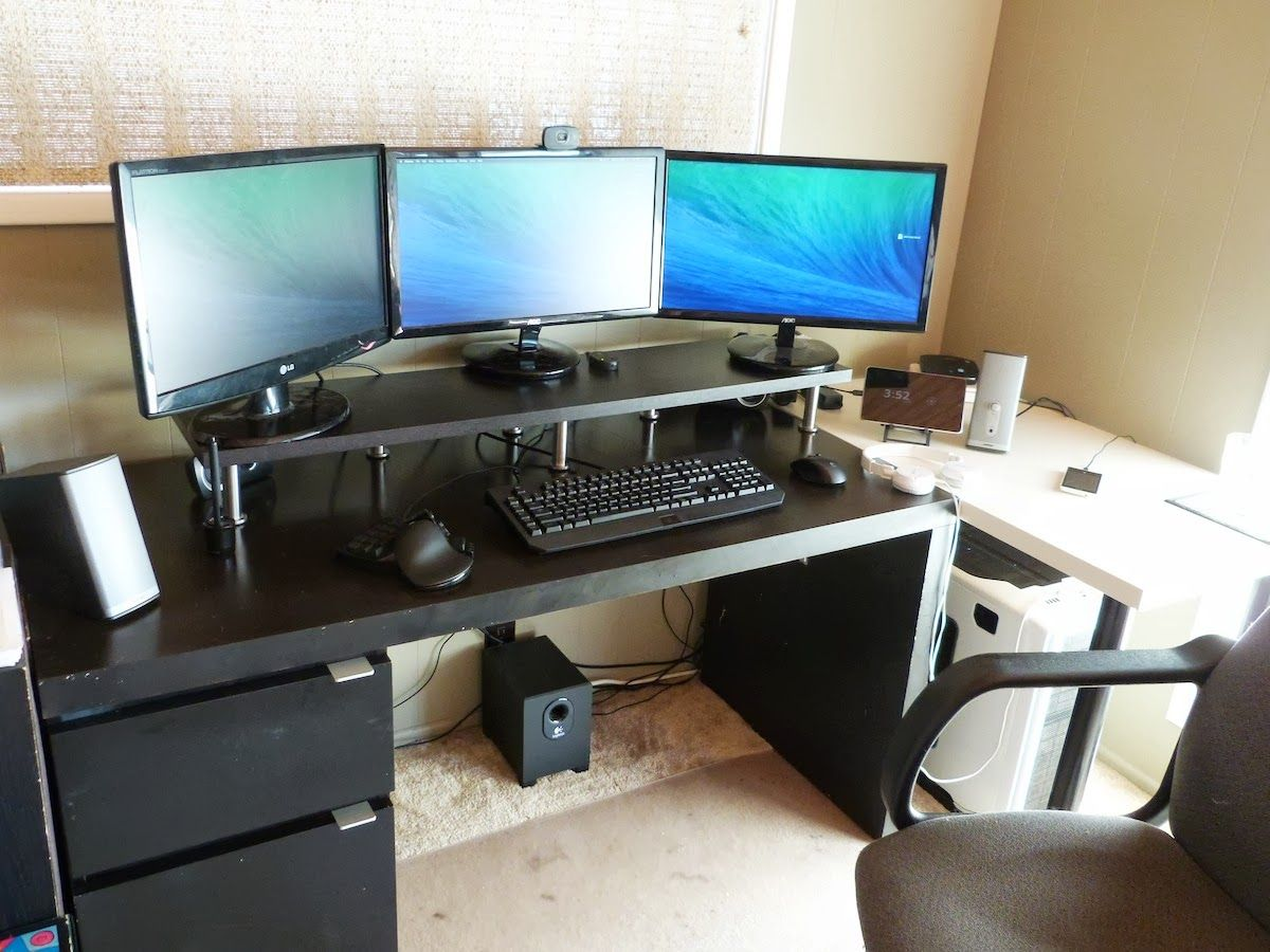 Black Ikea Computer Desk Setup With Triple Monitor Stand For