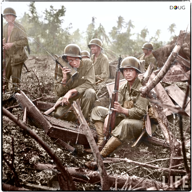 US Marines of the 1st Provisional Marine Brigade sit in pouring rain while  one of them uses a radio for communicati… | History war, World war two,  Military veterans