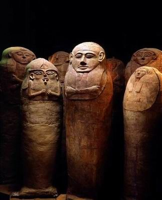 Sarcophagi at Deir el-Balah cemetery south of Gaza ca. 1300-1200 BCE. Late Canaanite period ~2mtrs with some lids depicting mummy-like figures. Although the bodies were not embalmed and often held more than one along with funerary gifts. Fashioned by hand using the coil technique as used for large vessels; and fired in an open furnace. The lids were later refired in kilns. Egyptian influence is evident in the Osiris-like beards.