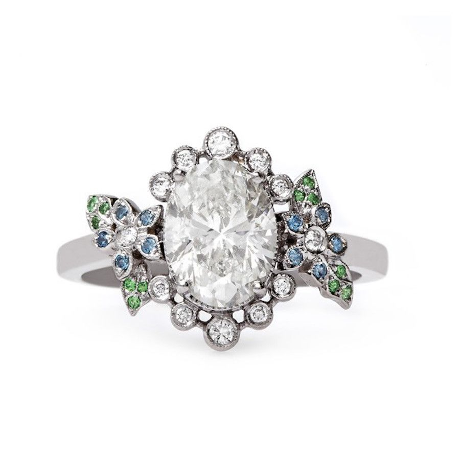 Trumpet & Horn oval-cut diamond ring with colorful embellishment: http://www.stylemepretty.com/collection/3348/