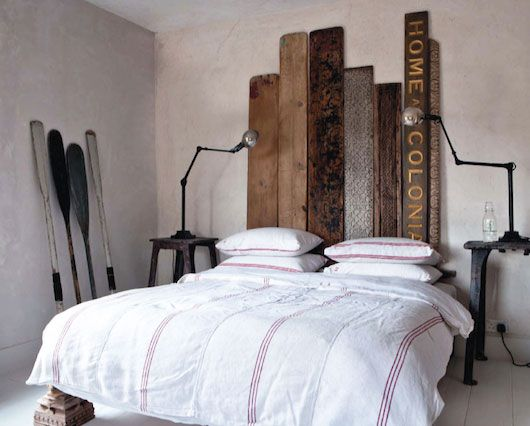 headboard made out of found wood planks and old store