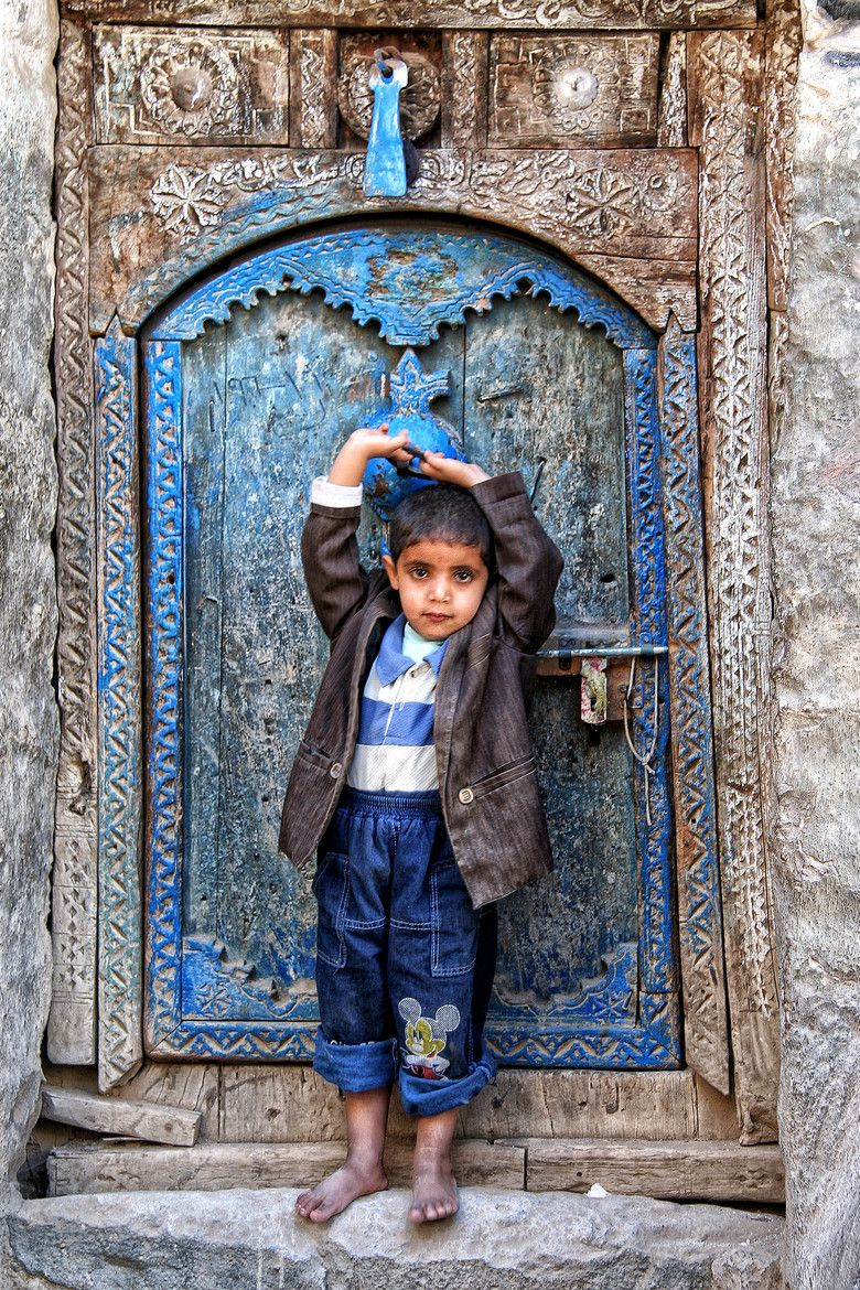 Boy at Door in Djibbla,Yemen, by Anna Carter