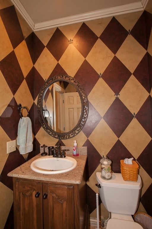 Traditional Powder Room with interior wallpaper, Built-in bookshelf, Crown molding